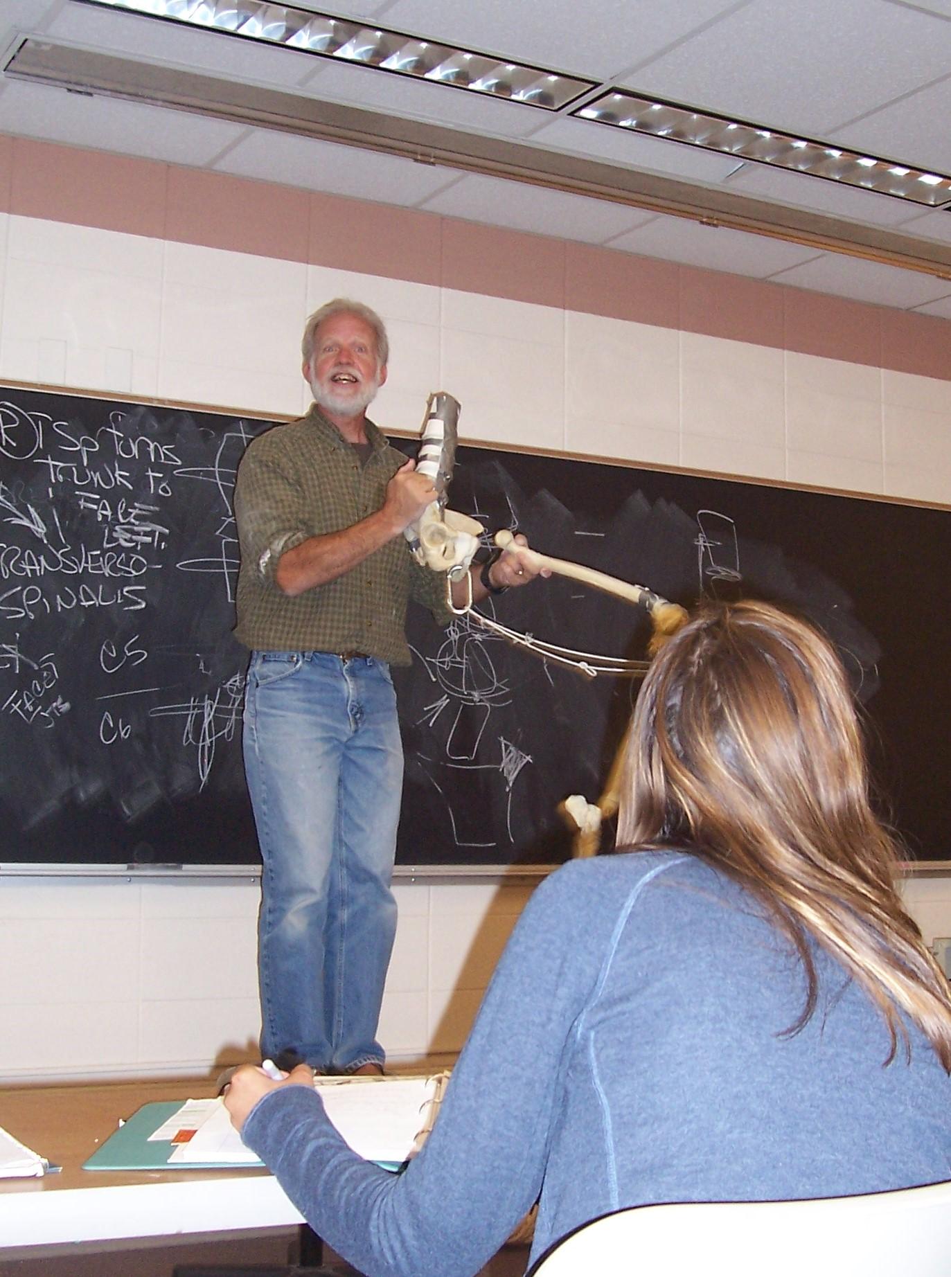 David Greene demonstrating human body movements with skeleton model