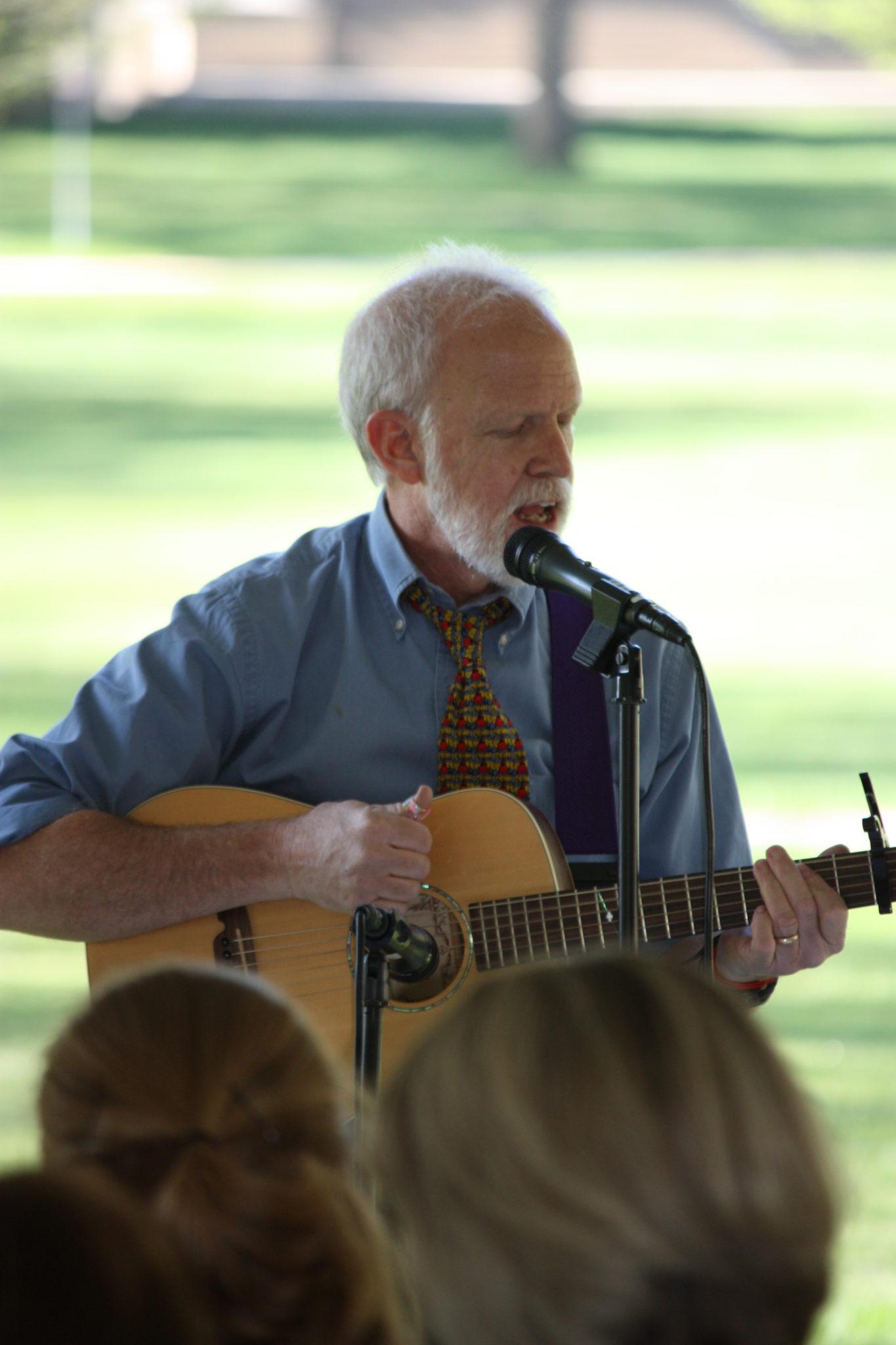 David Greene playing his guitar