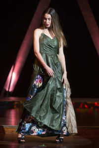 Model wearing a green and floral parachute dress