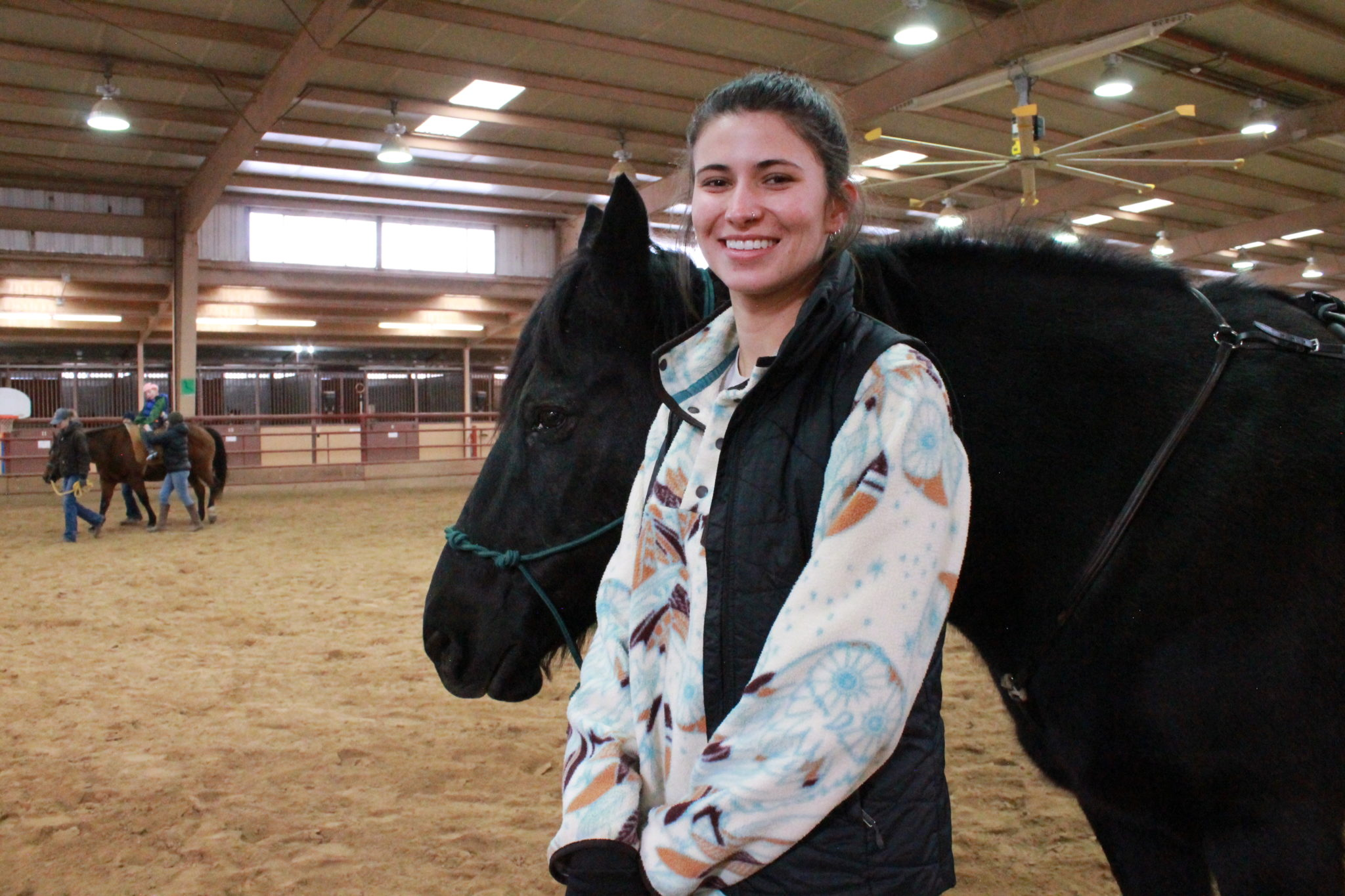 Molly Madden with a therapy horse