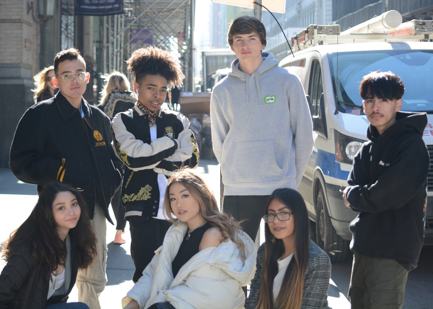 Outstanding grad Gio and friends pose on a New York City street.