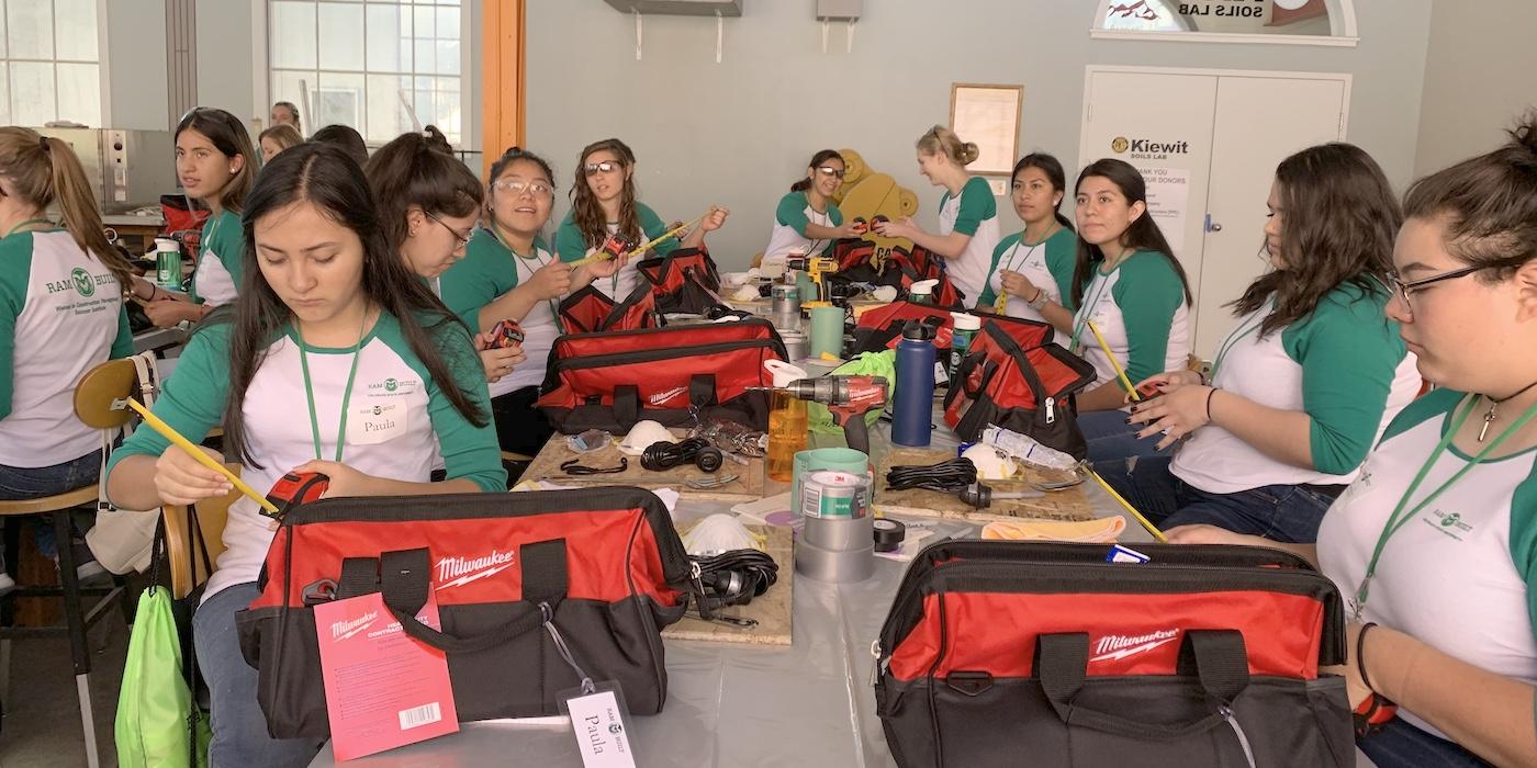Participants examining tools