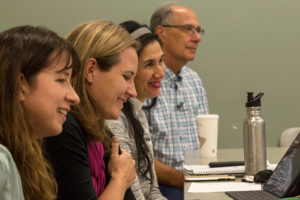 Education Equity Transformation faculty and student listen during colloquium