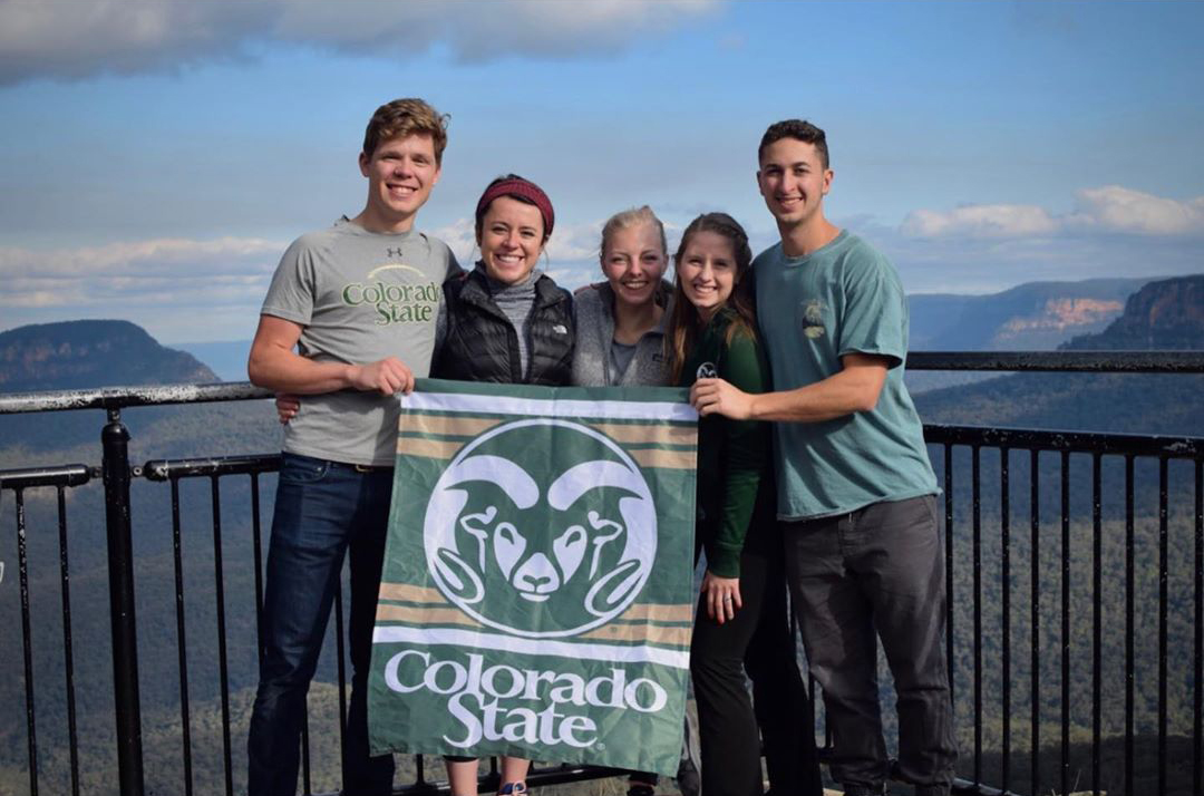 Phaelan Mead and her colleagues pose with CSU Ram flag.