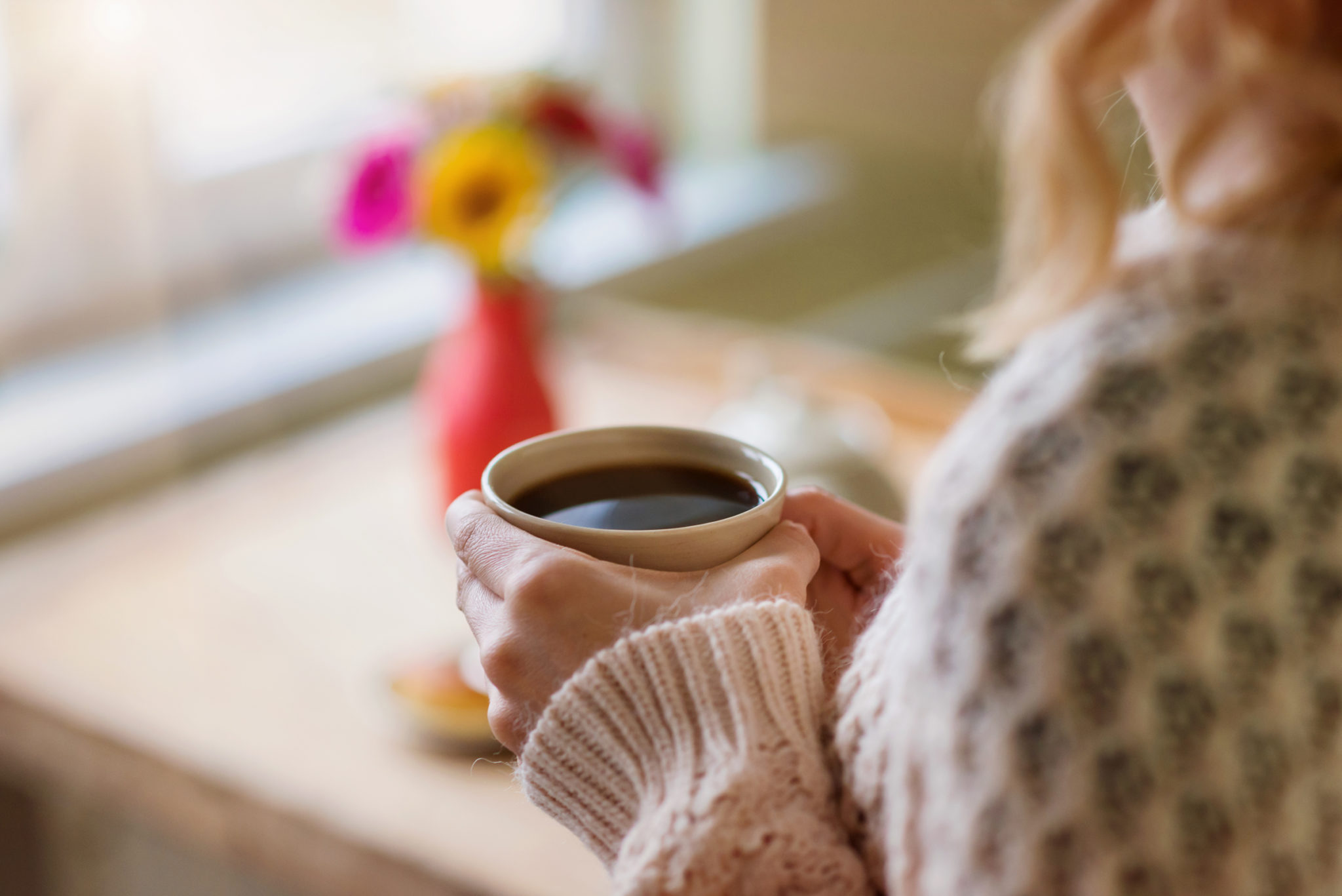 Woman relexing at home with a cup of coffee