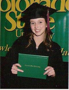 Sarah Jenk holding her diploma