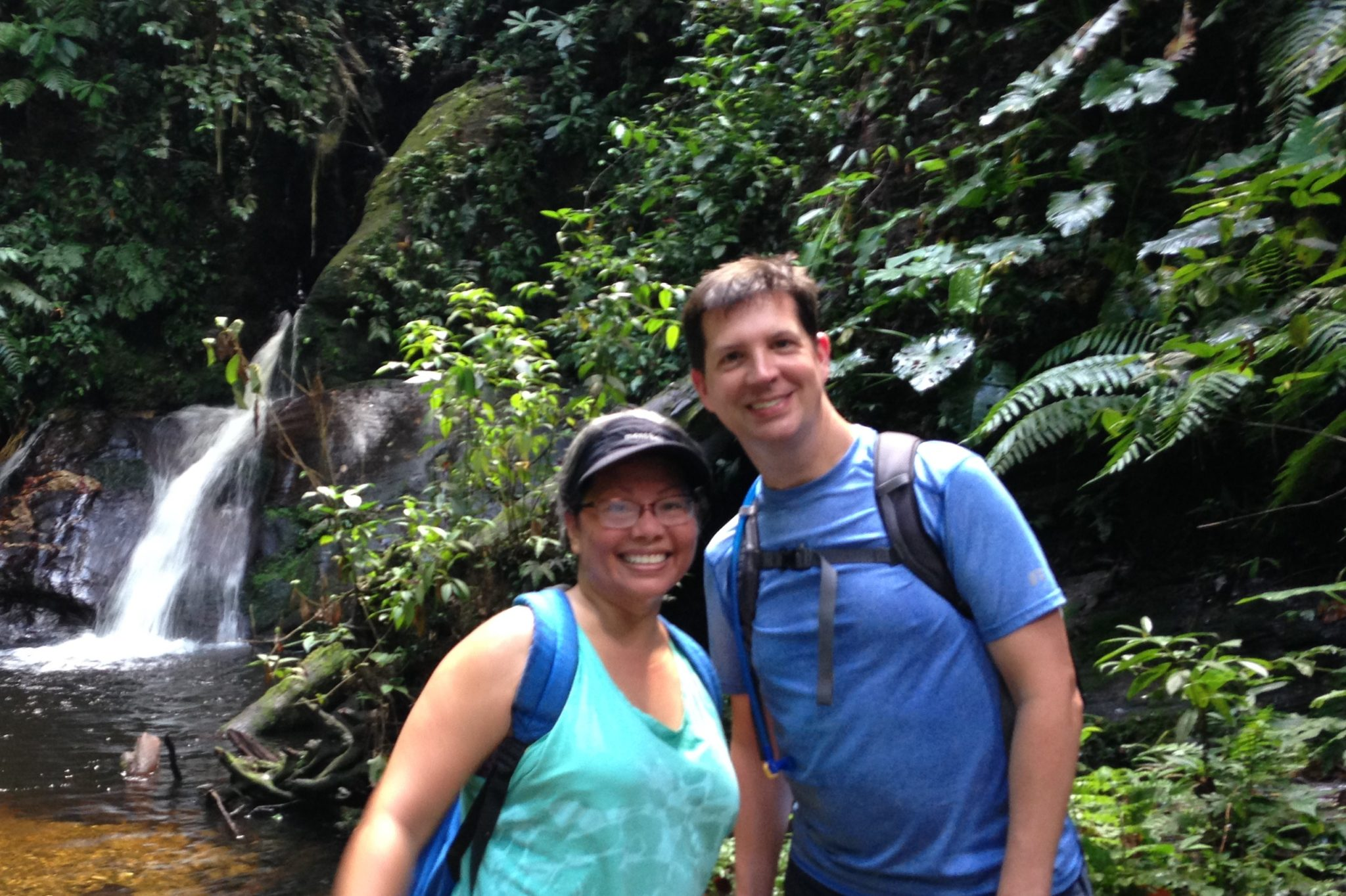 Lesley Garcia and Bill Roberts by a waterfall