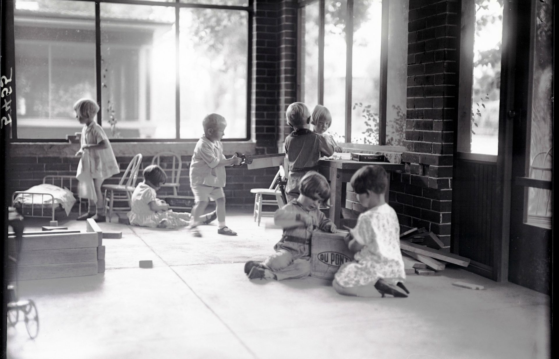 Children playing on the Laurel St. house porch