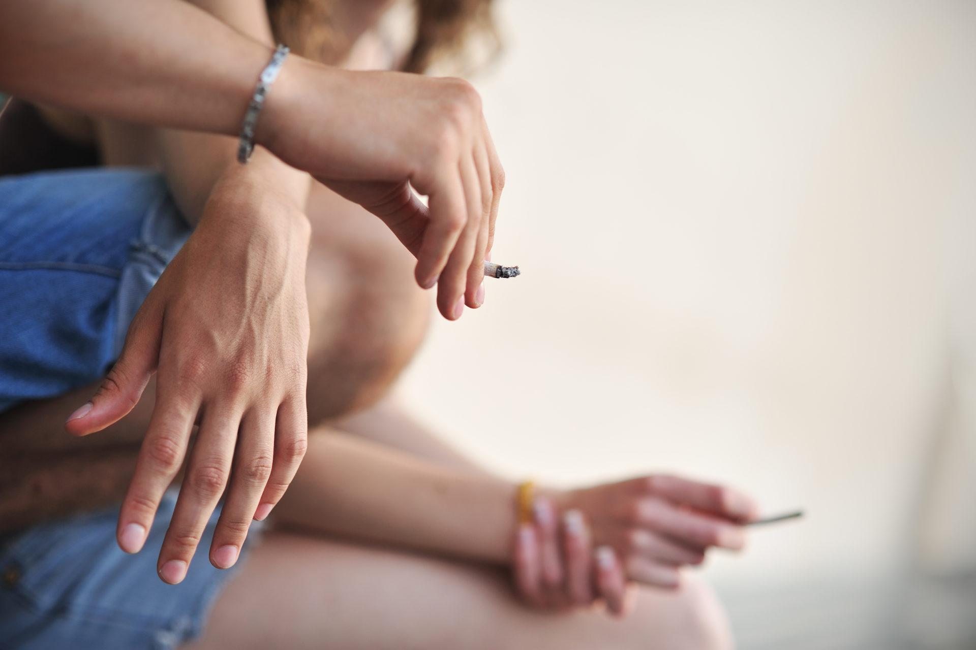 Young adults smoking marijuana