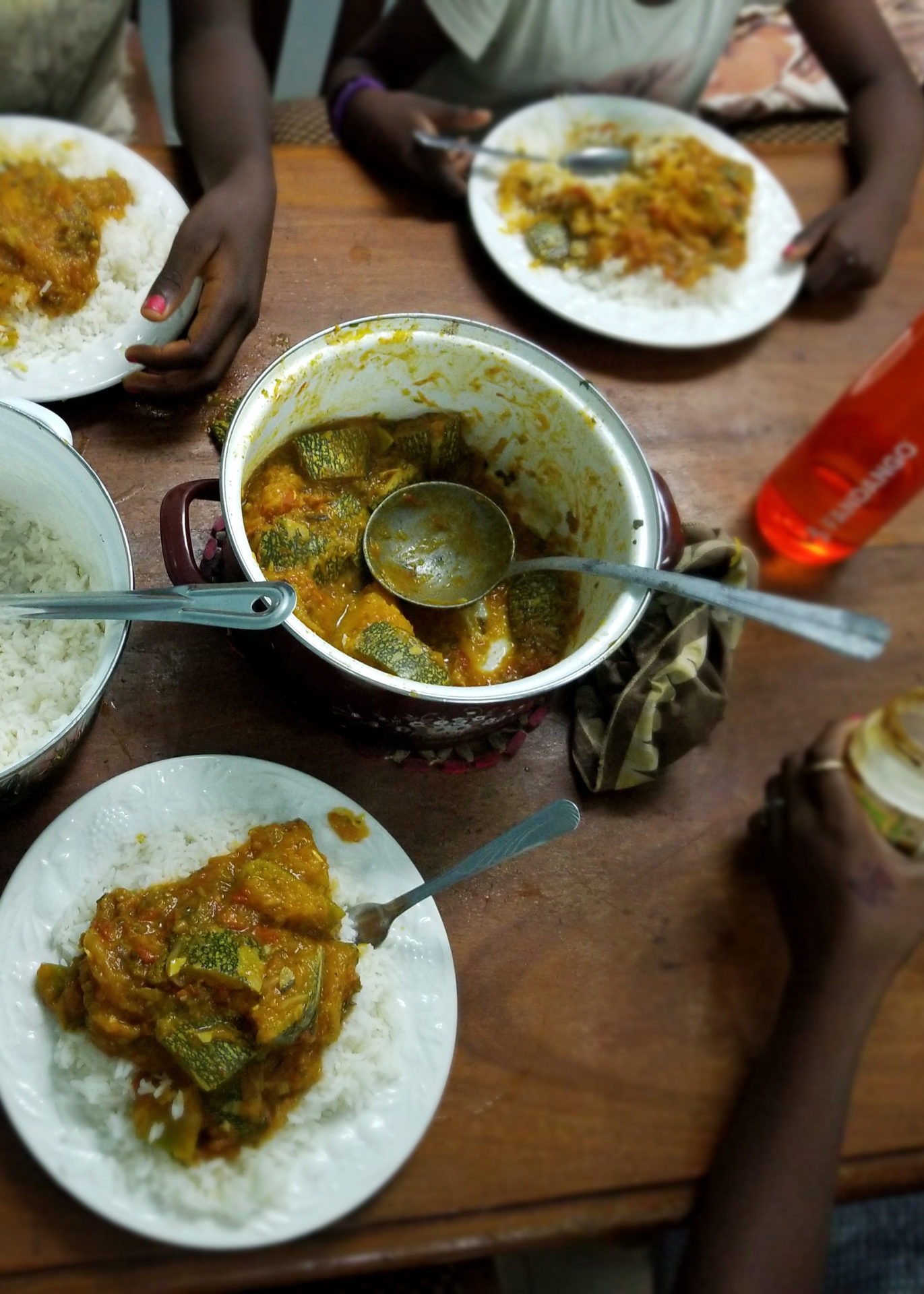 a meal of pumpkin stew cooked by ayana session is set on a dinner table