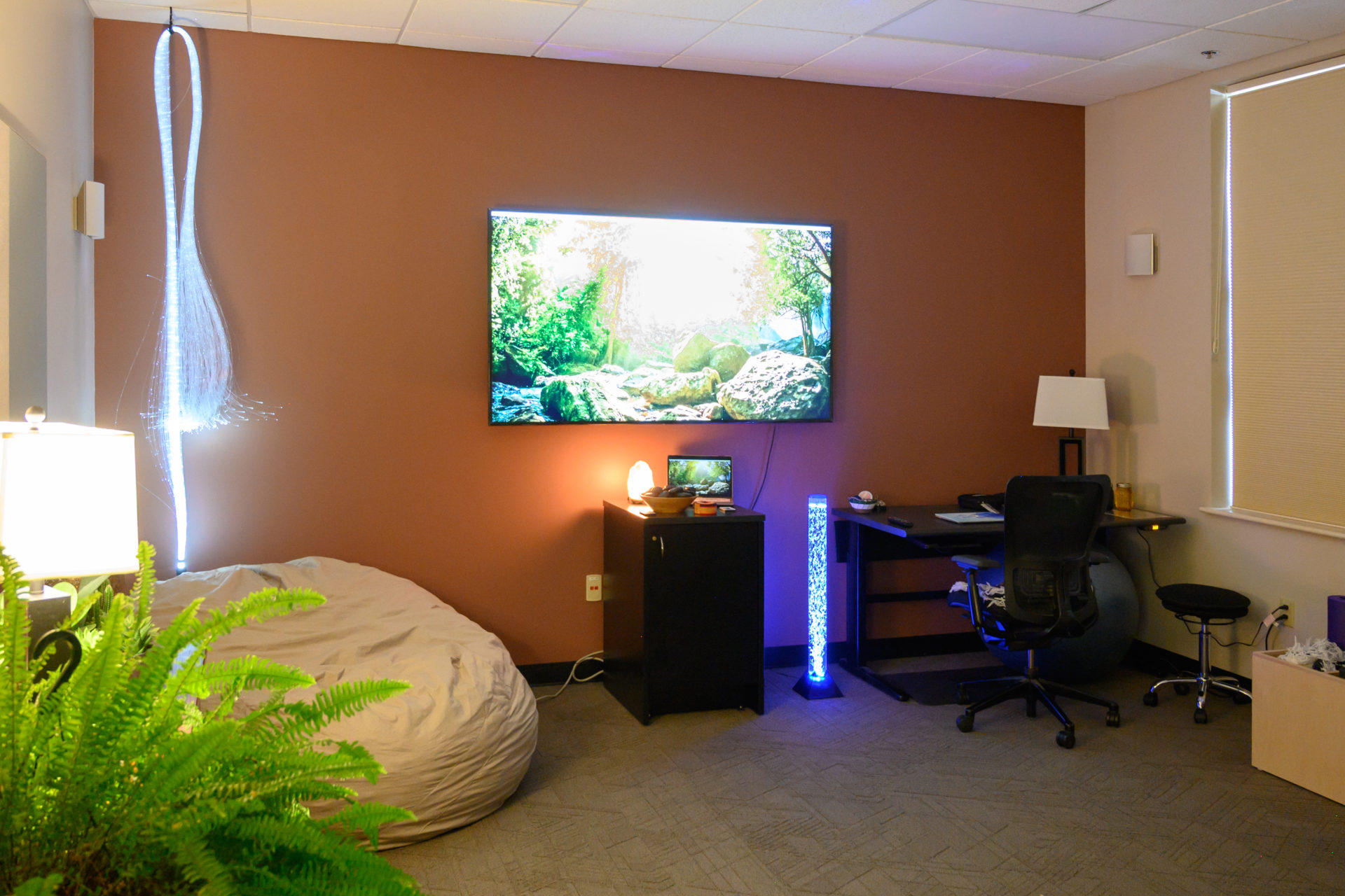 A screen and mood lighting in the Well-Being Room