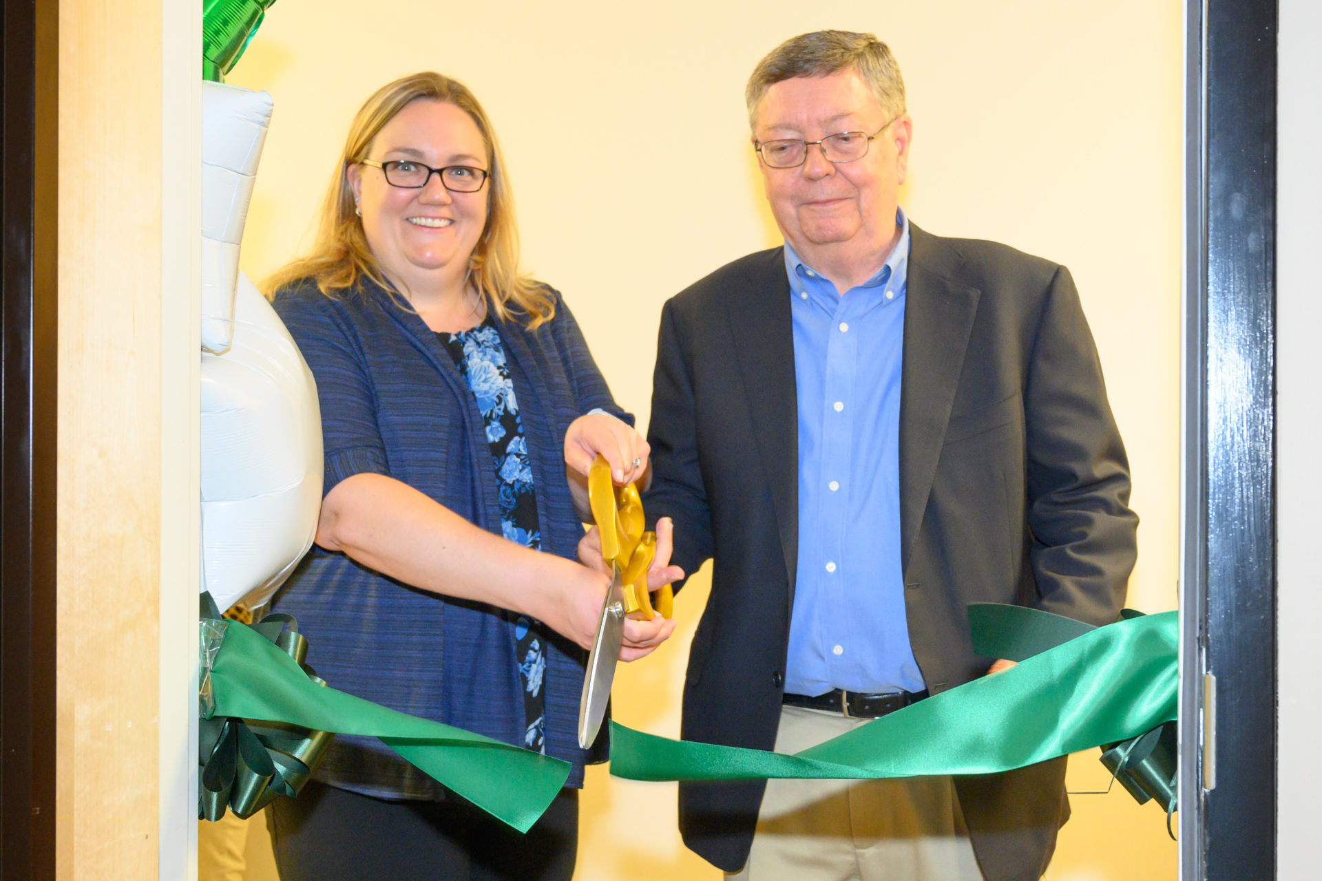 Amanda Donovan and Dan Freeberg cut the ribbon
