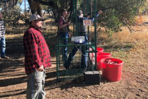 In the clay shoot cage, firing a shot