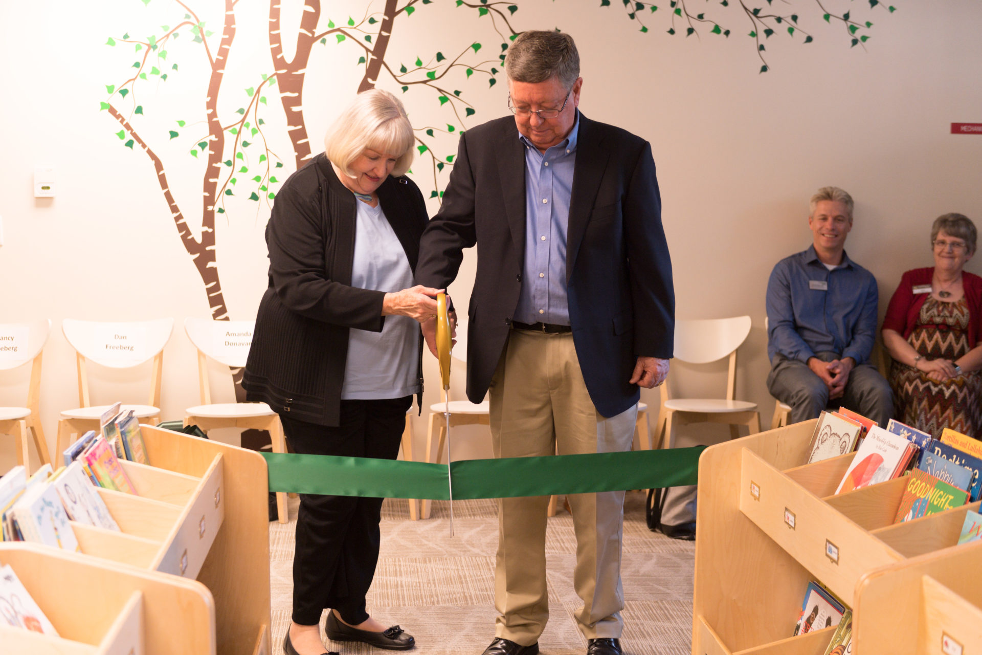 Don and Nancy Freeberg cutting the ribbon at the ECC
