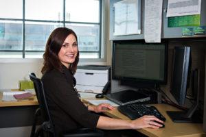 Bielak sitting at her office desk