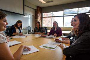 Bielak discusses ideas during a meeting