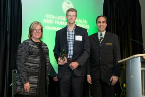 Dean Youngblade, Chris Lierheimer and Mehmet Ozbek with Chris' award