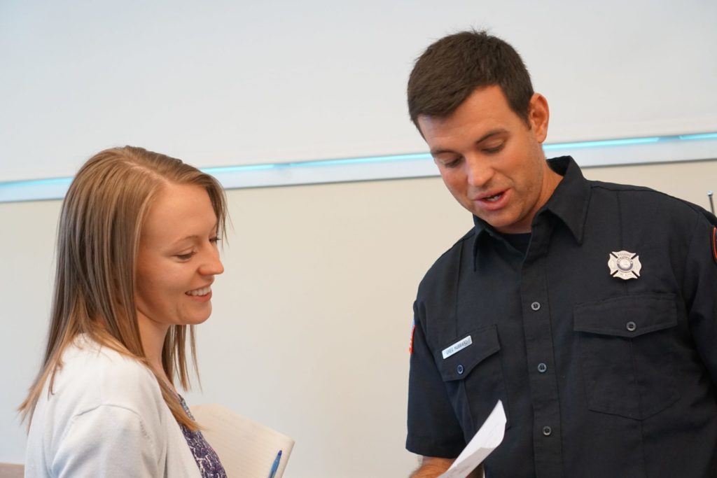 A student talks to the Poudre Fire Authority about their upcoming internship opportunities promoting fitness among their team