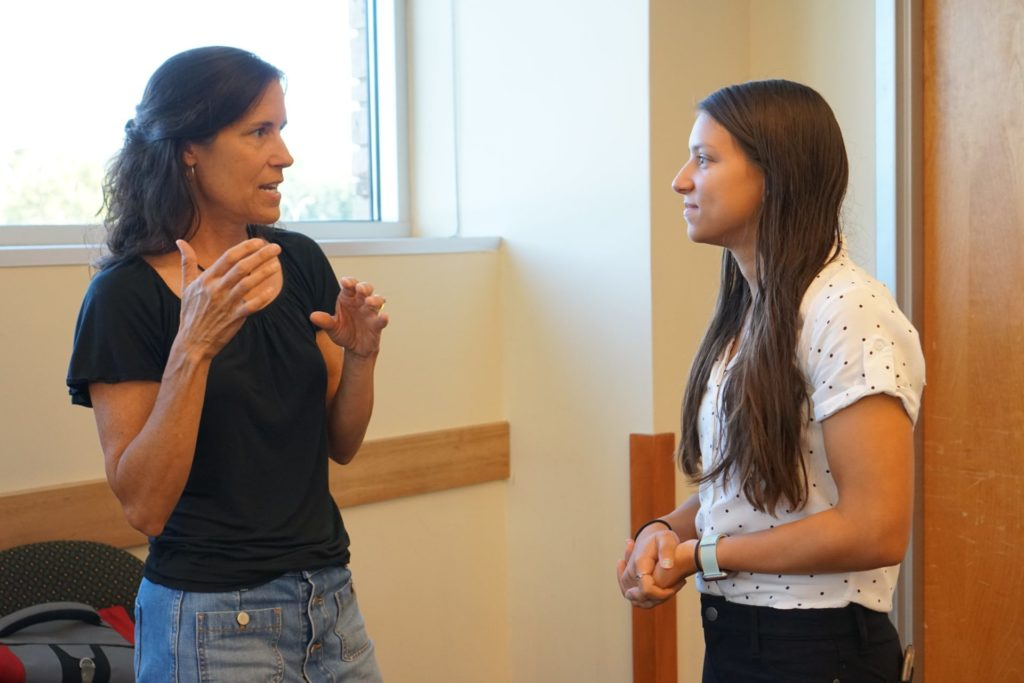 A student talks with the representative from Thompson School District, Kathy Schlepp