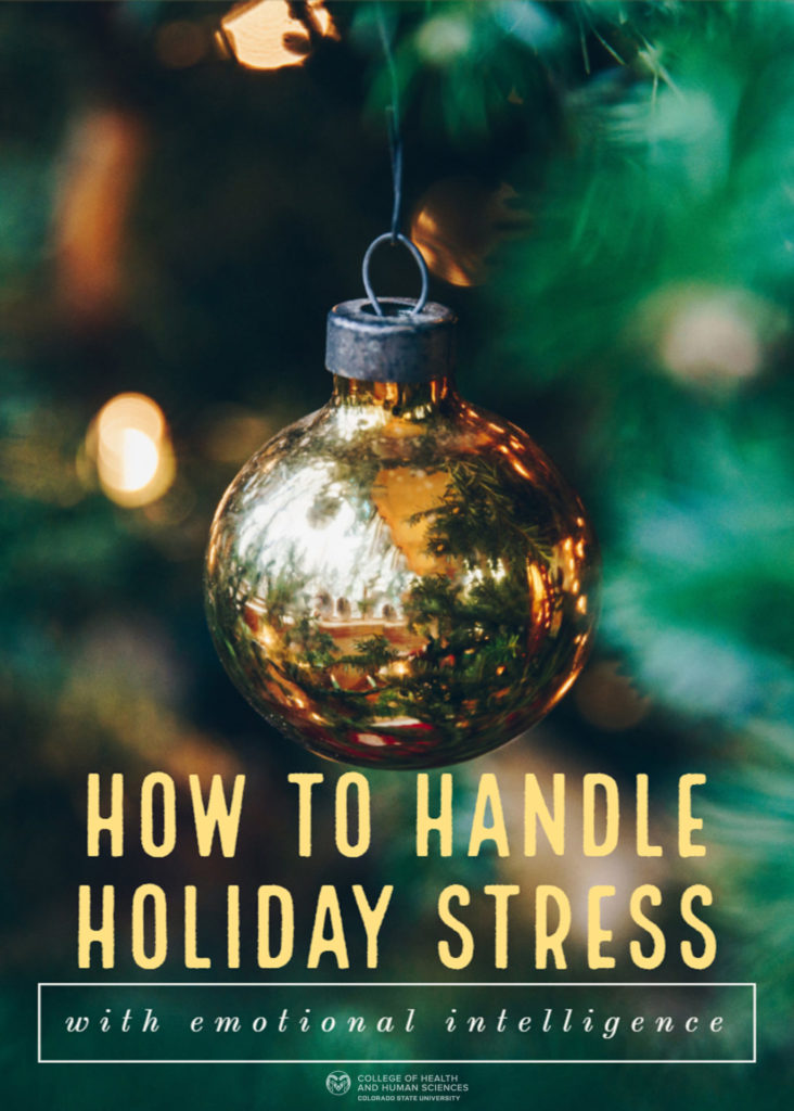 "Gold ornament on Christmas tree. ""How to Handle Holiday Stress with emotional intelligence."""