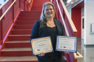 Kristen Morris holds her two award certificates.