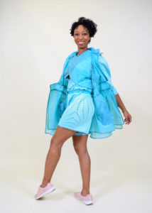 A model wearing Morris' aqua colored active wear garments.