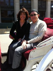 Patty with her husband on carriage ride at Philadelphia AOTA Conference