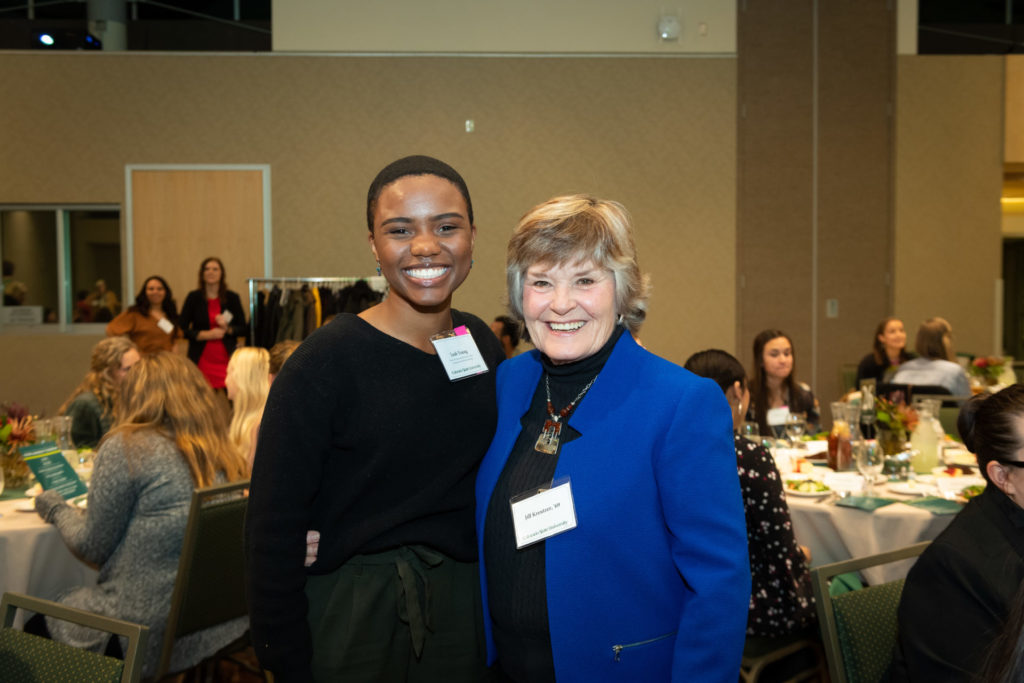 Student and scholarship donor smiling in a photo.