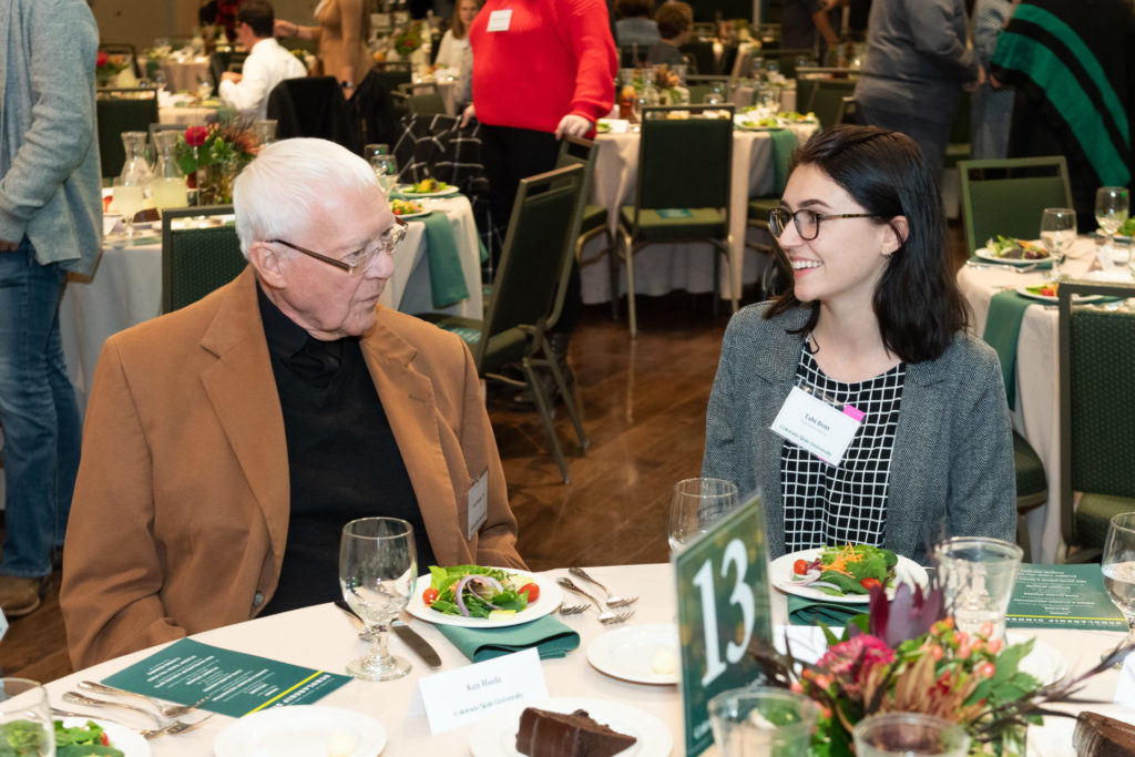 Student talking to a donor at the dinner table.