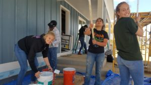 WE CM women working at Habitat for Humanity project