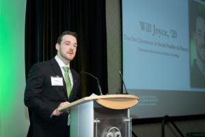 William Joyce speaking on stage at the scholarship dinner.