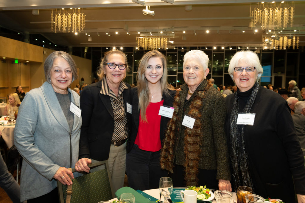 Student standing with her scholarship donors for the Tarr scholarship.