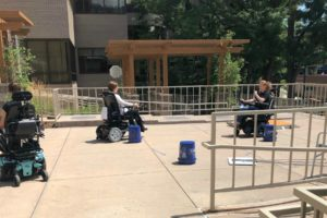 Participants test wheelchair turning radius on an obstacle course.