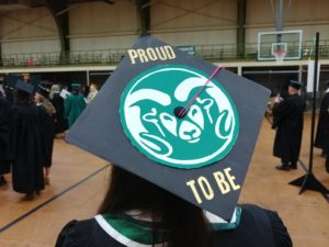 "A graduation cap, decorated with the Ram's Head Logo. Text reads ""Proud to Be."""