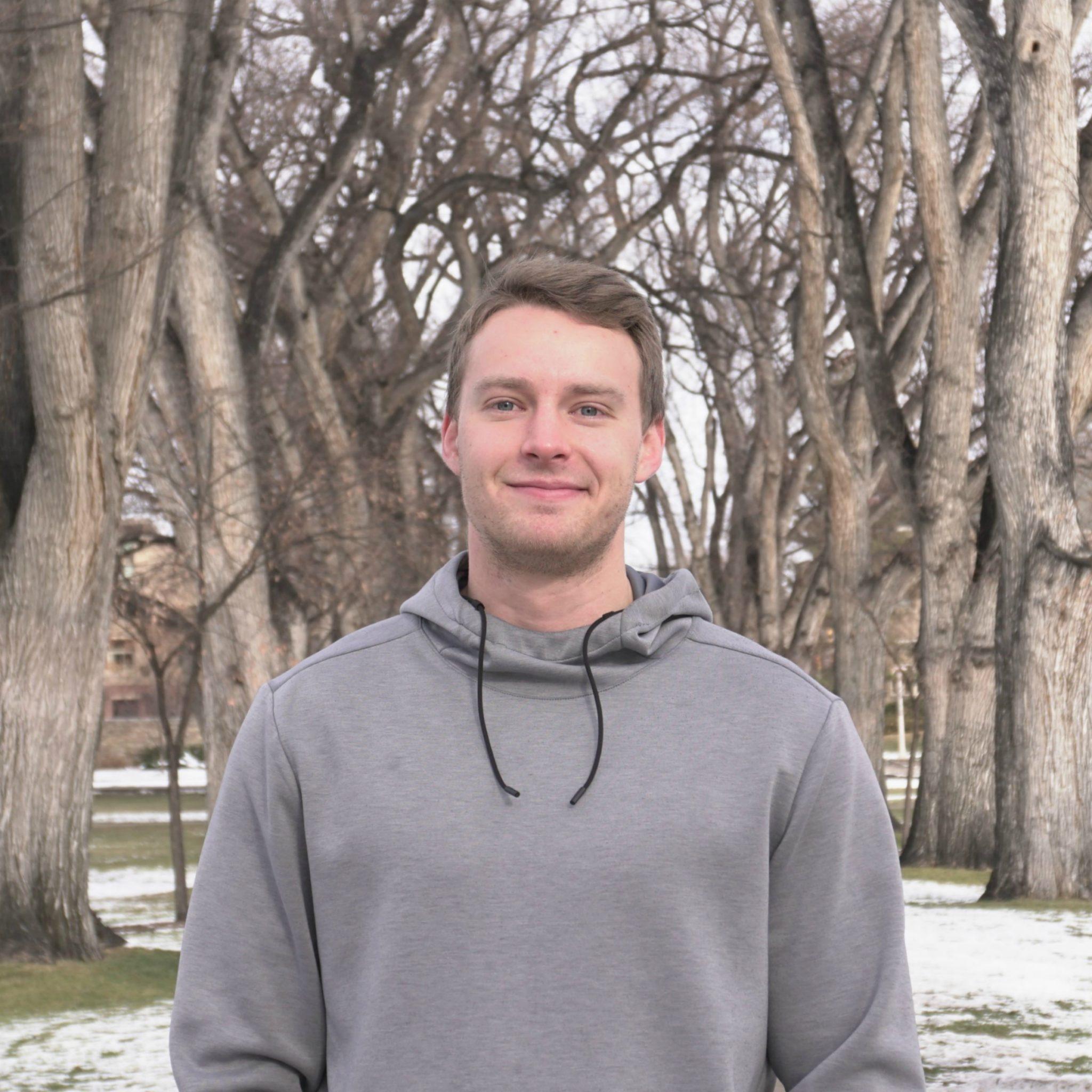 Alden Erickson smiling in profile picture in CSU oval.