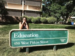 Angela Bautista smiling in front of the CSU education building
