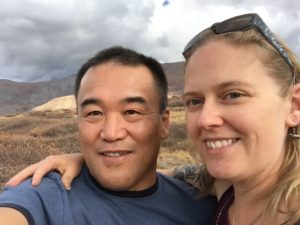 Anne and her husband smiling in selfie.