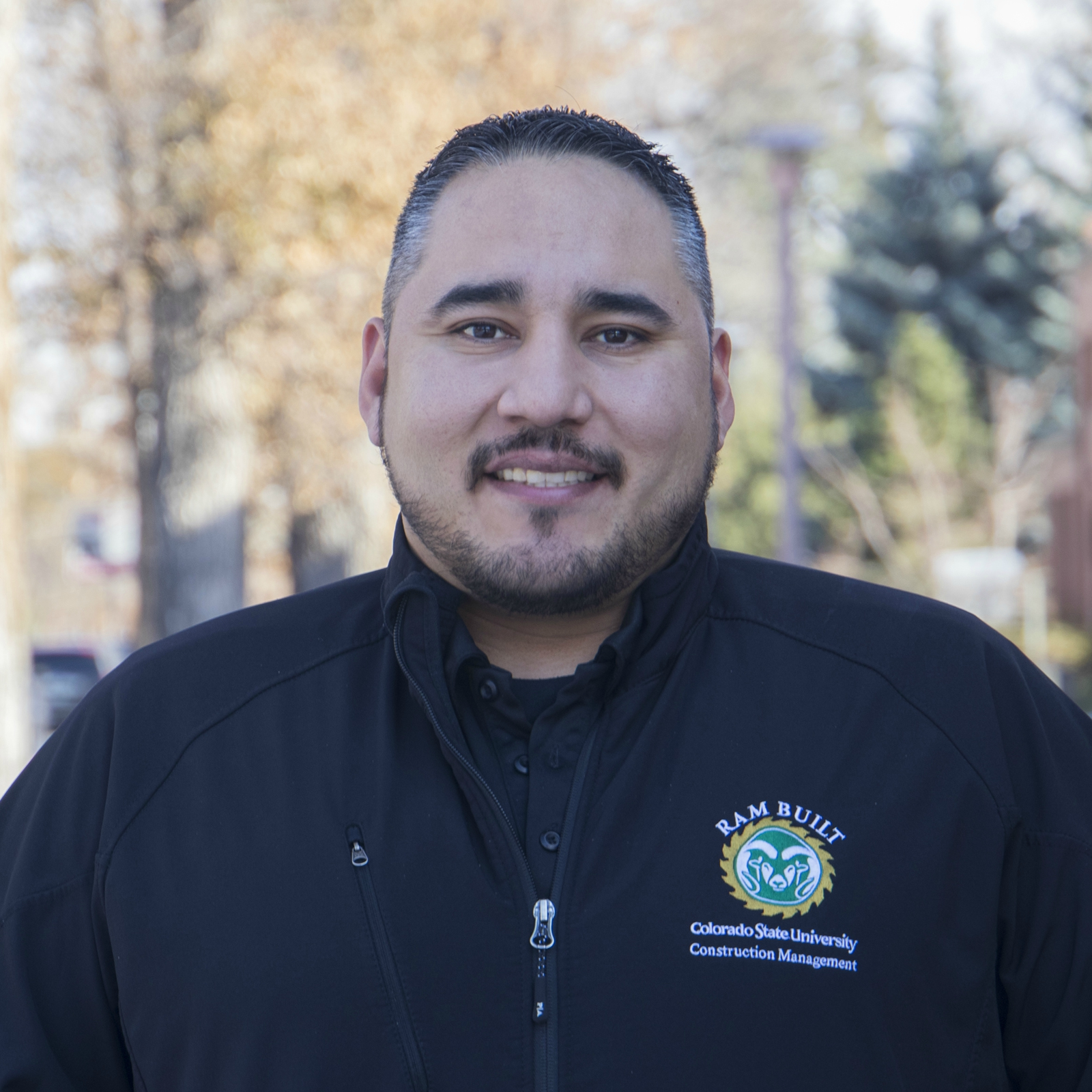 Diego Ruiz smiling profile picture wearing a ram built jacket
