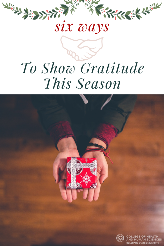 Woman holds small gift box: Six ways to show gratitude this season.