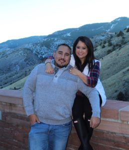Diego and his wife Joselin smiling at Red Rocks for their engagement photo