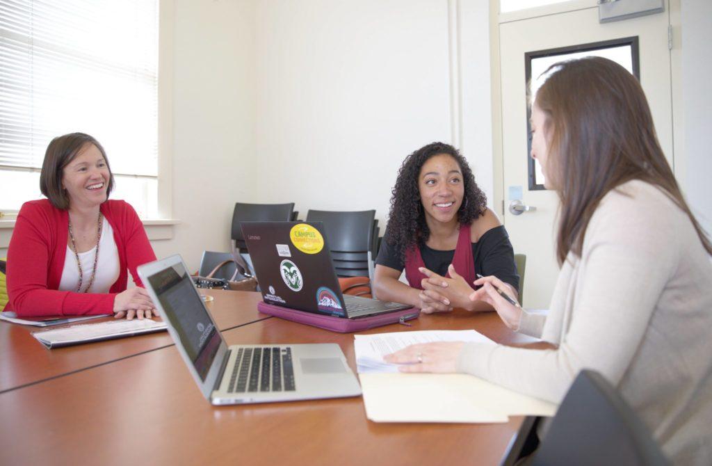 Brooke Pottinger talks to lab members.