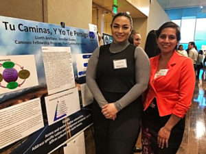 Jennifer Gomez and Lizeth Arellano pose with their research poster