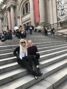 Kyndrick Peachey and friend smiling on stairs in New York City.