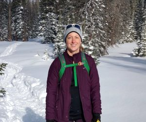 Megan Wadley hiking in a snow-covered woodland