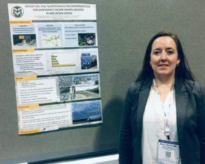 Ph.D. Student Deniz Besiktepe with research poster