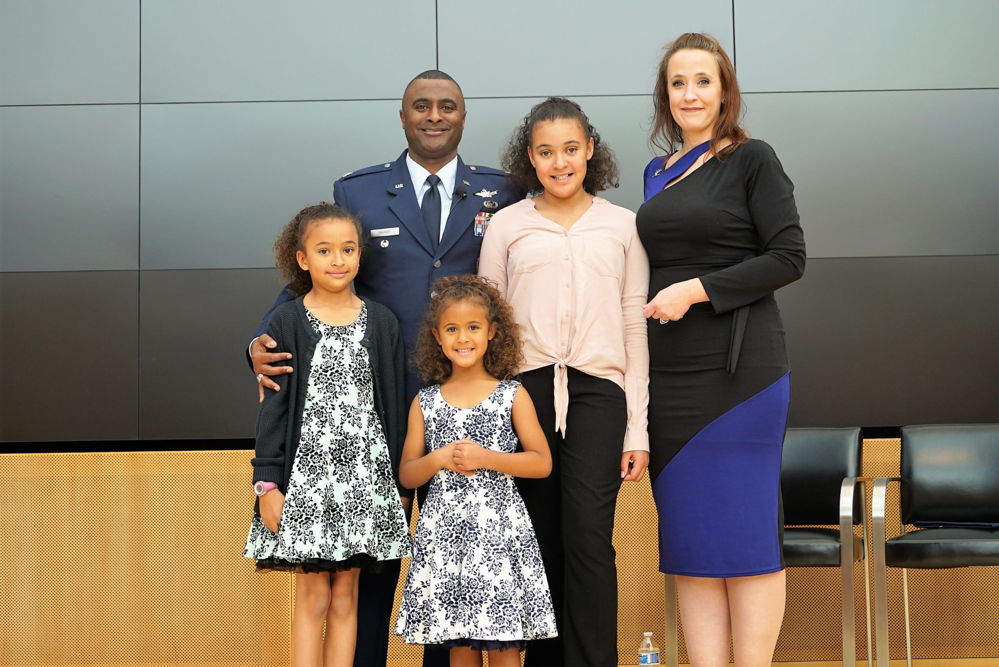 Rainey with wife and three daughters.