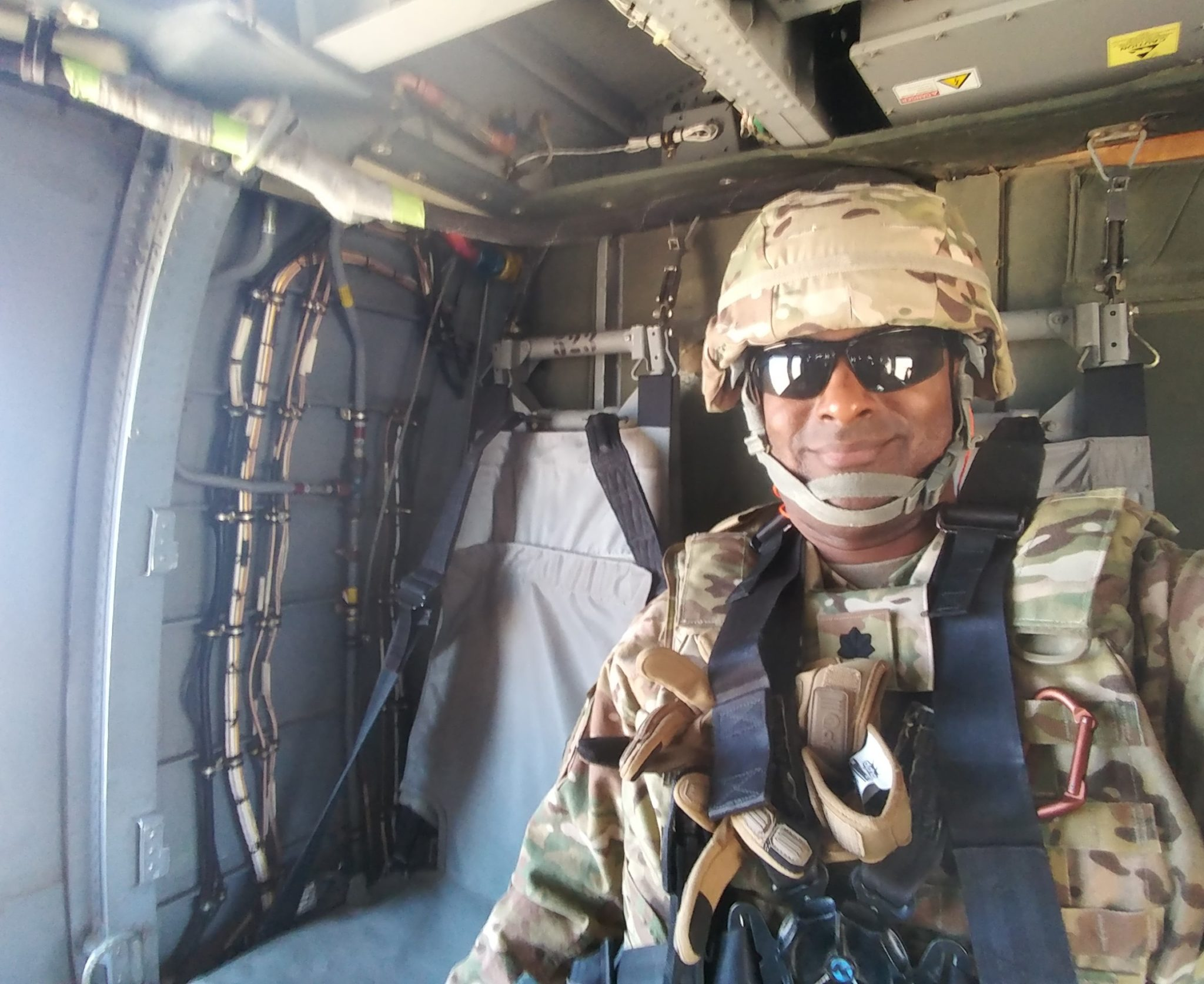 Rainey dresed in his uniform in an air craft.