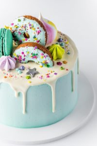 Decorated cake with donuts on top