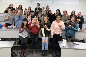 Pumpkin decoration event during a peer mentoring class.
