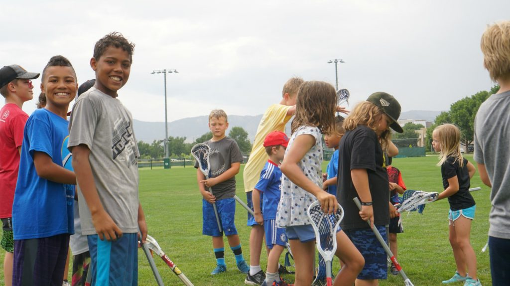 Youth in Lacrosse camp smiling